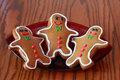 Three gingerbread boy cookies Stock Photography