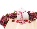 Three gingerbread hearts in the background of sachet petals Stock Image