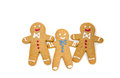 Three gingerbread men isolated on white background Stock Photography