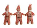 Three gingerbread santa clause cookie figures brown with color icing shot on white background Royalty Free Stock Photography