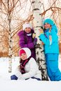 Three girl in birch forest cute girls the on winter snowy day Stock Photos