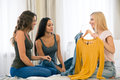Three girlfriends choosing cloth at home Royalty Free Stock Photo