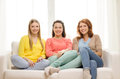 Three girlfriends having a talk at home friendship and happiness concept Royalty Free Stock Images