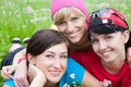 Three girlfriends in sports clothes portrait of young beautiful girl outdoor Royalty Free Stock Images