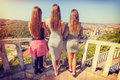 Three girls from behind watching panorama of the city Royalty Free Stock Photo