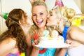 Three girls celebrating birthday Stock Photos