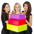 Three girls with colorful boxes on white background Stock Photo