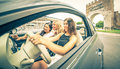 Three girls driving around in the city and listening to music Stock Photography