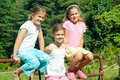 Three Girls on Fence/Triplets Royalty Free Stock Photo