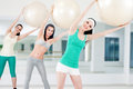 Three girls in fitness club Royalty Free Stock Photo