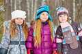 Three girls friends stand in park winter Stock Photos