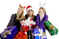 Three girls hand over New Year's gifts Royalty Free Stock Images