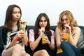 Three girls with juice glasses Royalty Free Stock Photo