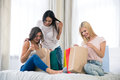 Three girls with many shopping bags Royalty Free Stock Photo