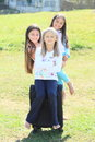 Three girls prepared for traveling with suitcase barefoot packed chech in baggage Stock Photography