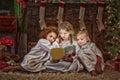 Three Girls Reading Christmas Story Book Royalty Free Stock Photo