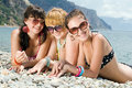 Three girls on seashore Royalty Free Stock Image