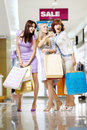 Three girls in shop Royalty Free Stock Photography
