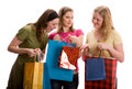 Three girls with shopping bags. Isolated on white Stock Image