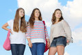 Three girls stand together Royalty Free Stock Photo