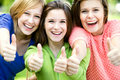 Three girls with thumbs up Stock Image