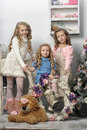 Three girls waiting in christmas Stock Images