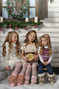 Three girls waiting in christmas Stock Image