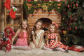 Three cute girls waiting for Christmas Royalty Free Stock Photo