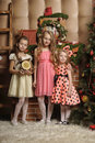 Three girls waiting in christmas Stock Photography