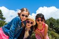 Three girls wearing sunglasses portrait of friends together outdoors Royalty Free Stock Photos
