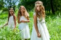 Three girls wearing white dresses in woods portrait of girl friends Stock Photography