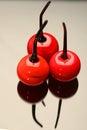 Three glass cherries Royalty Free Stock Photo