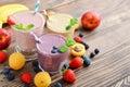 Three glass of fruit milkshakes Royalty Free Stock Photo