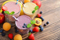 Three glass of fruit milkshakes Royalty Free Stock Photo
