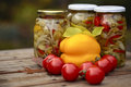 Three glass jars of homemade preserves on wooden table Stock Image