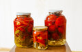 Three glass jars with marinated tomatoes homemade Royalty Free Stock Photo