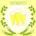 Three glasses of beer, barley stalks and branches of hops, Oktoberfest