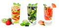 Three glasses of fruit infused water isolated on white Royalty Free Stock Photo