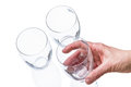 Three glasses hand white background Royalty Free Stock Images