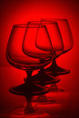 Three glasses in red light Royalty Free Stock Photo