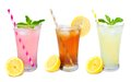 Three glasses of summer drinks with straws isolated on white Royalty Free Stock Photo