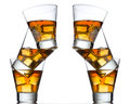 Three glasses of whiskey on the rocks isolated one top other white Stock Images