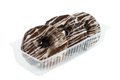 Three glazed donuts chocolate in the plastic container Stock Photo