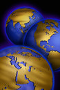 Three Globes With Maps Of Different Continents Stock Photos