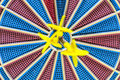 Three goals blurred in bulls eye of dartboard Royalty Free Stock Photo