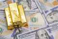 Three gold bar with hundred dollar bills Royalty Free Stock Photo