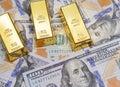 Three gold bar with new american hundred dollar bills Royalty Free Stock Photo