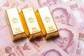 Three gold bar with thai hundred baht bills Royalty Free Stock Photo