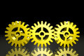 Three Gold Gears Stock Image