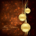 Three golden Christmas balls Stock Photo
